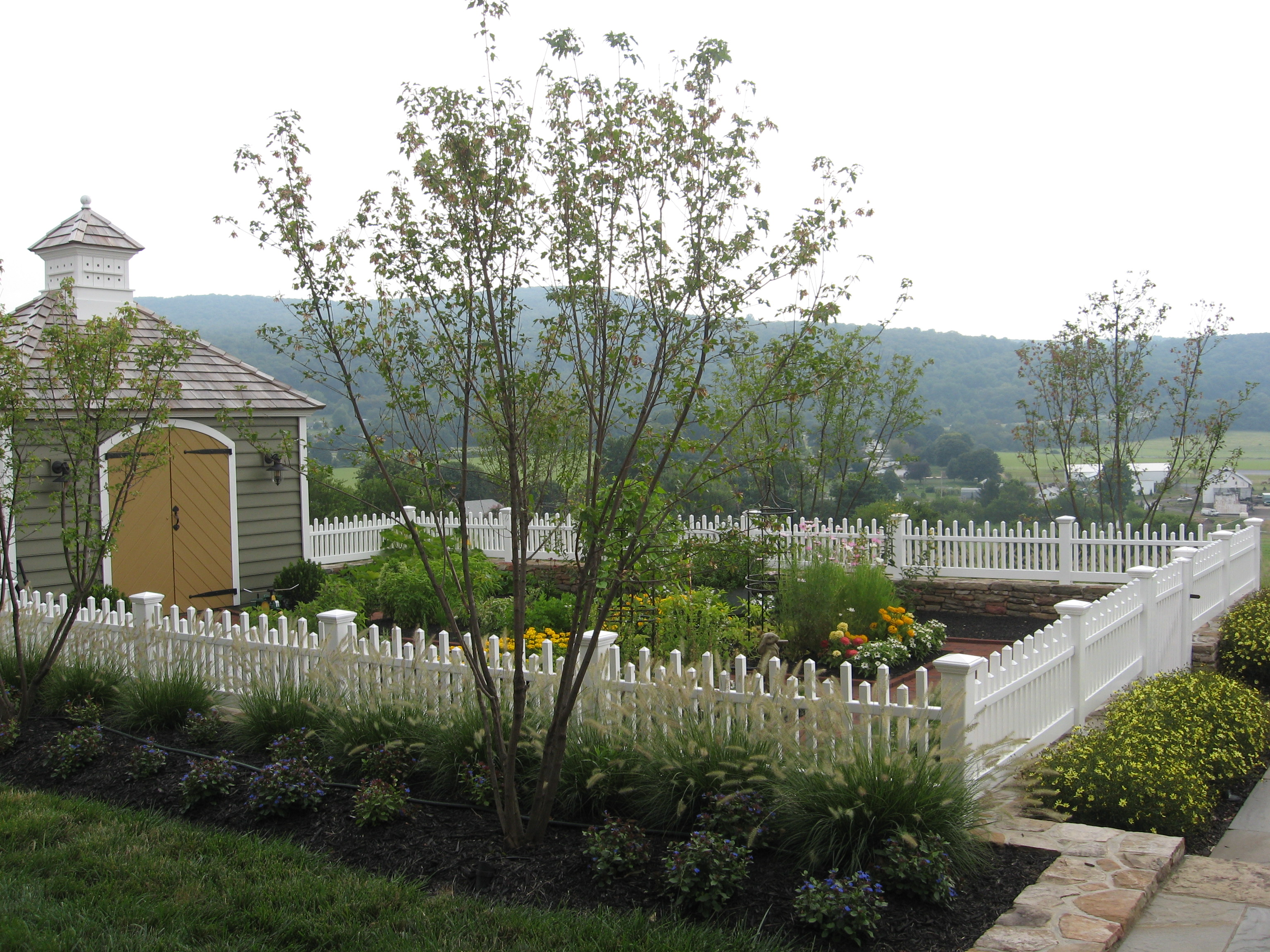 Custom Fencing enclosing Potager Garden