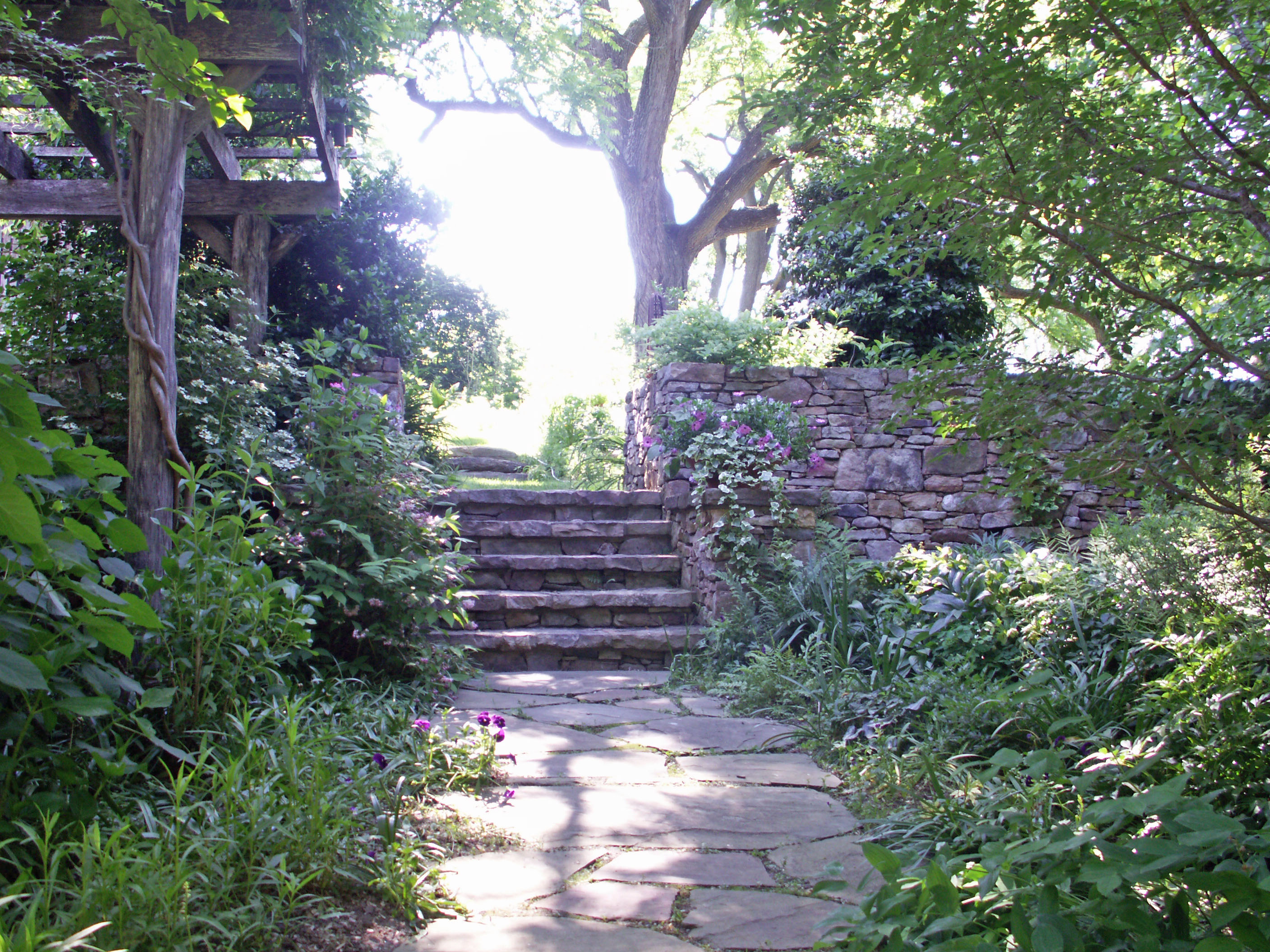 Natural stone walkway leading to stone stairs
