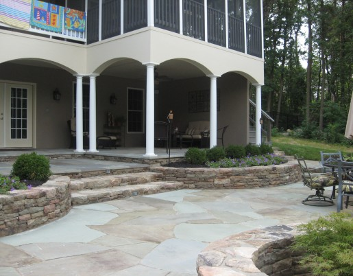 Stone steps and walls help accent a multi-level flagstone patio