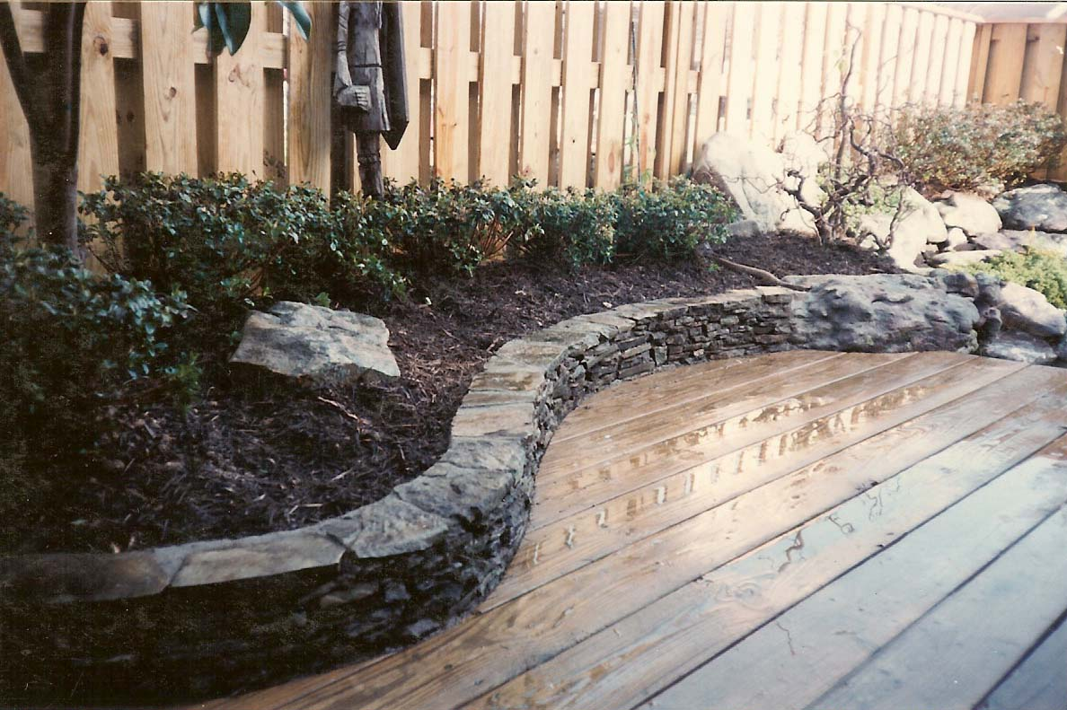 Low stone wall enhancing the planting area
