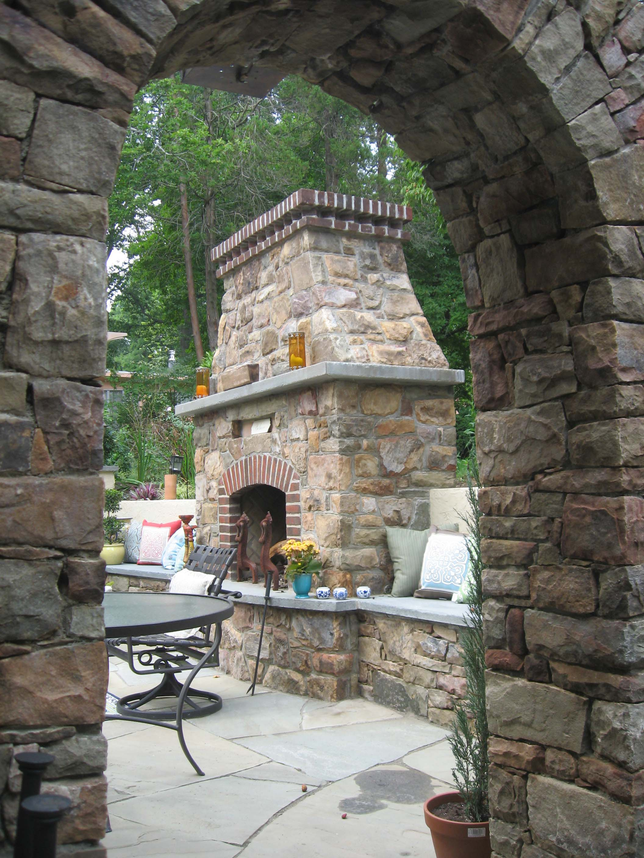 Custom stone fireplace trimmed with brick