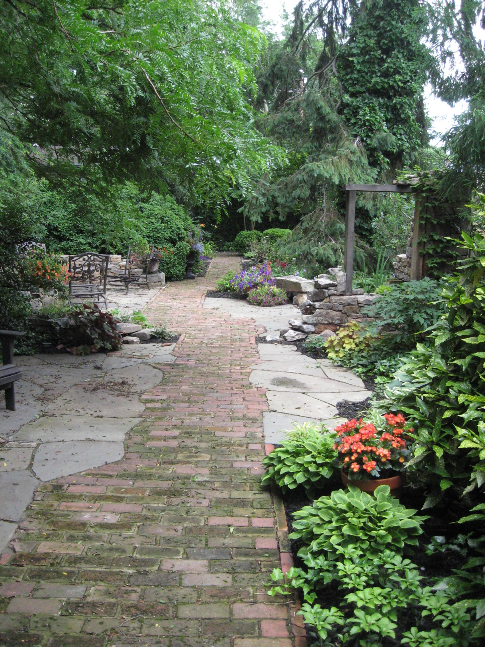 The Rustic Elegance of a Brick path through stone patios