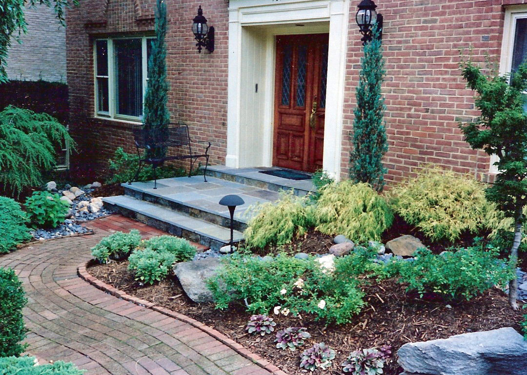 Enhanced front stone porch with brick walkway