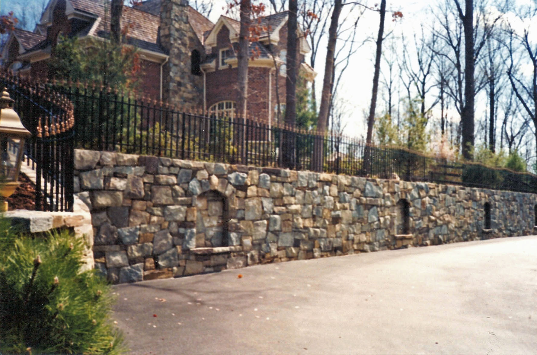 Unique Stone Wall with arched seating areas