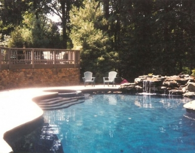 Turn your pool into a backyard oasis with the use of stone
