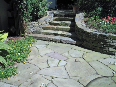 Natural stone steps with stone walls containing the gardens