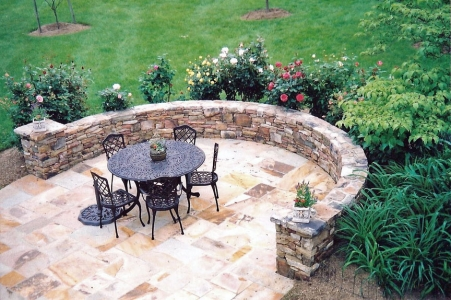 Beautiful stone patio with stone wall