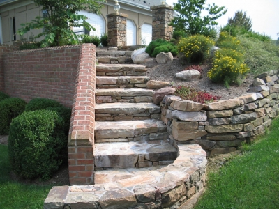 Custom stone stairs with brick & stone retaining walls