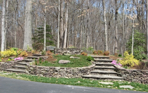 Custom stone stairs with stone retaining walls
