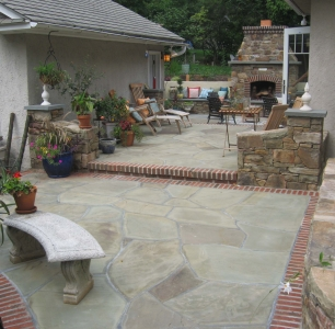 Outdoor room featuring irregular flagstone patio bordered with brick-Baltimore MD