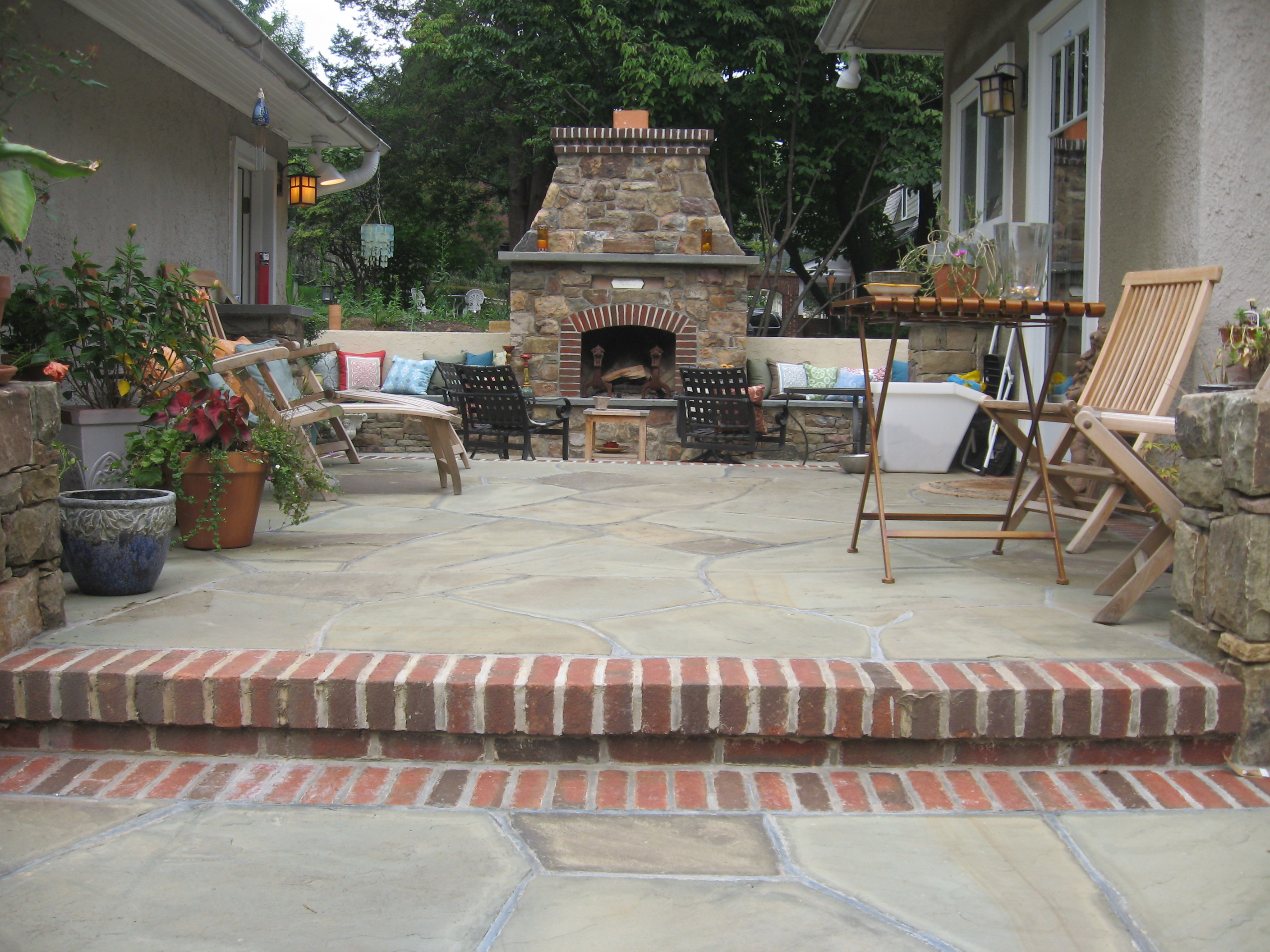 Irregular flagstone patio accented with brick