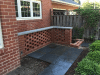 pierced-brick-privacy-wall-with-flagstone-cap