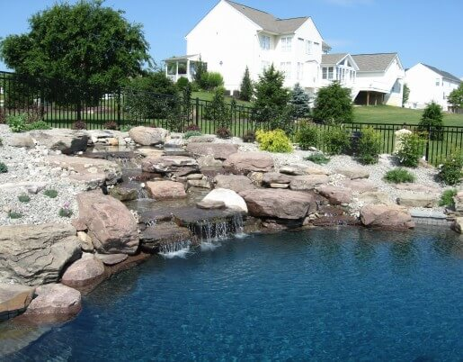 117 Pool with Boulder Waterfall Built Into Hillside