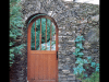 stone-arched-doorway-and-wall