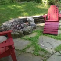 Loosely Laid Flagstone Patio with Stone Retaining Wall and Firepit