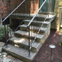 New Cantilevered Landing and Steps on Historic Home