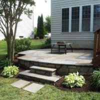 231 Above-Grade Flagstone Patio with Stone Veneer and Stone Steps