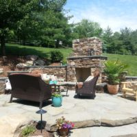 232 Flagstone Patio Built Into Hillside with Stone Fireplace and Terraced Stone Retaining Walls with Caps