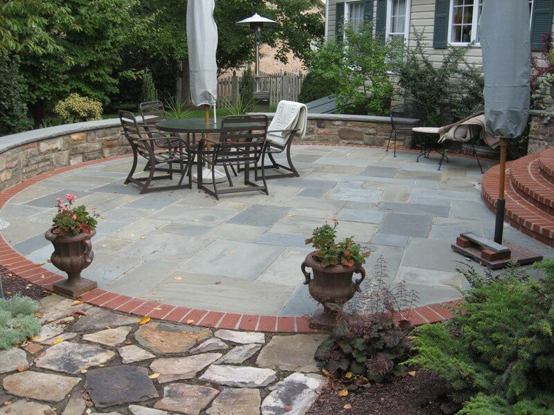 237 Circular Flagstone Patio with Brick Border and Capped Stone Sitting Wall