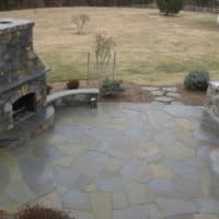 238 Flagstone Patio with Stone Outdoor Fireplace and Curved Stone Sitting Walls