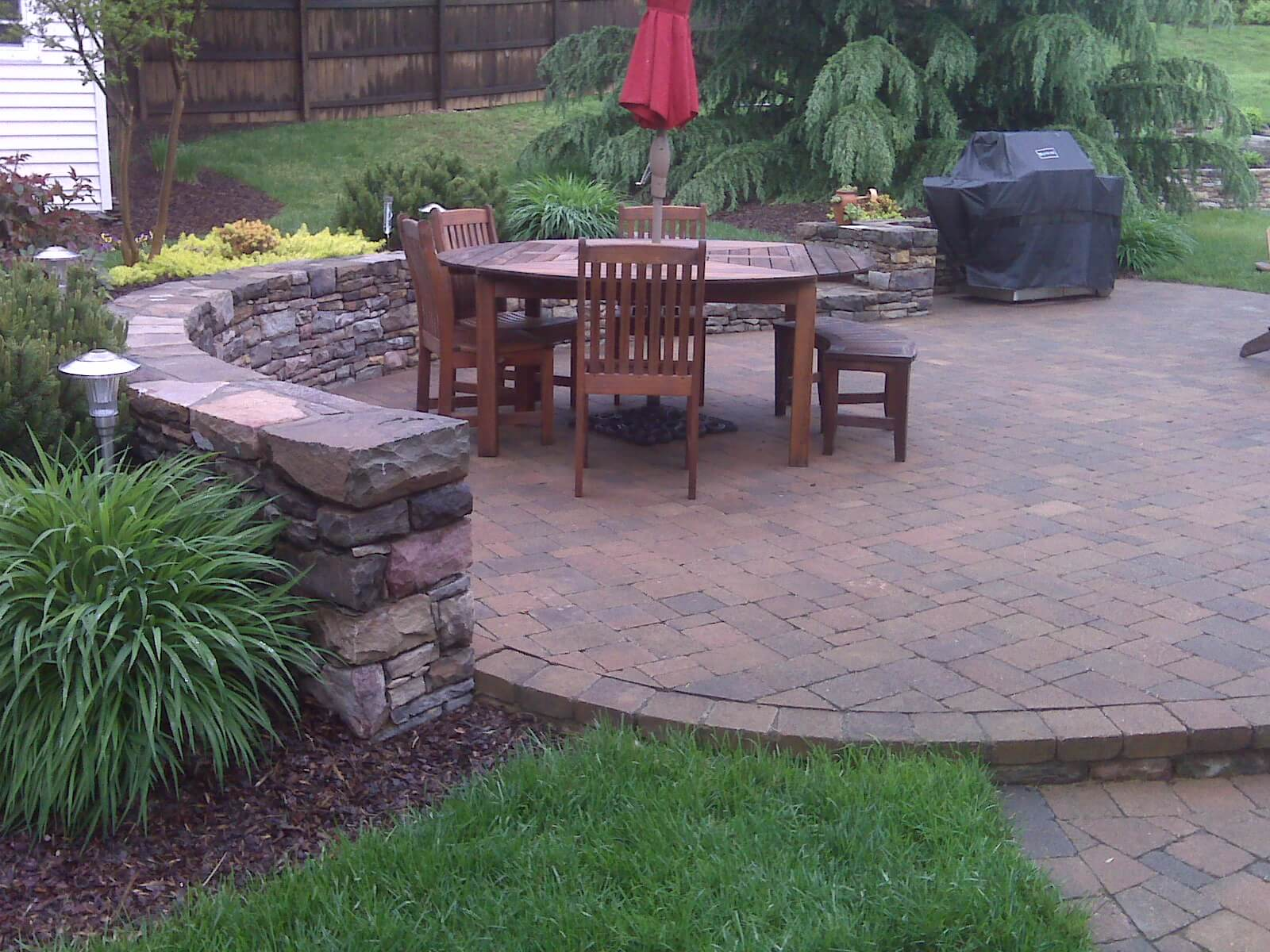 239 Circular Paver Patio and Double-Sided Stone Garden and Retaining Wall