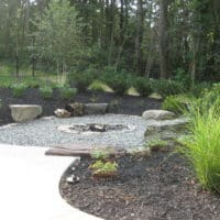 252 Low-Profile Wood-Burning Firepit with Boulder Seating and Gravel Surround