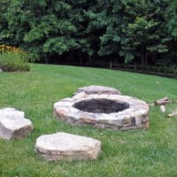 260 Stone Firepit Set Into Lawn with Sitting Boulders