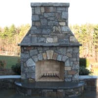 261 Lake George Stone Fireplace with Flagstone Hearth and Stone Sitting Walls