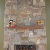 268 Two Story Stone Fireplace with Timber Mantle