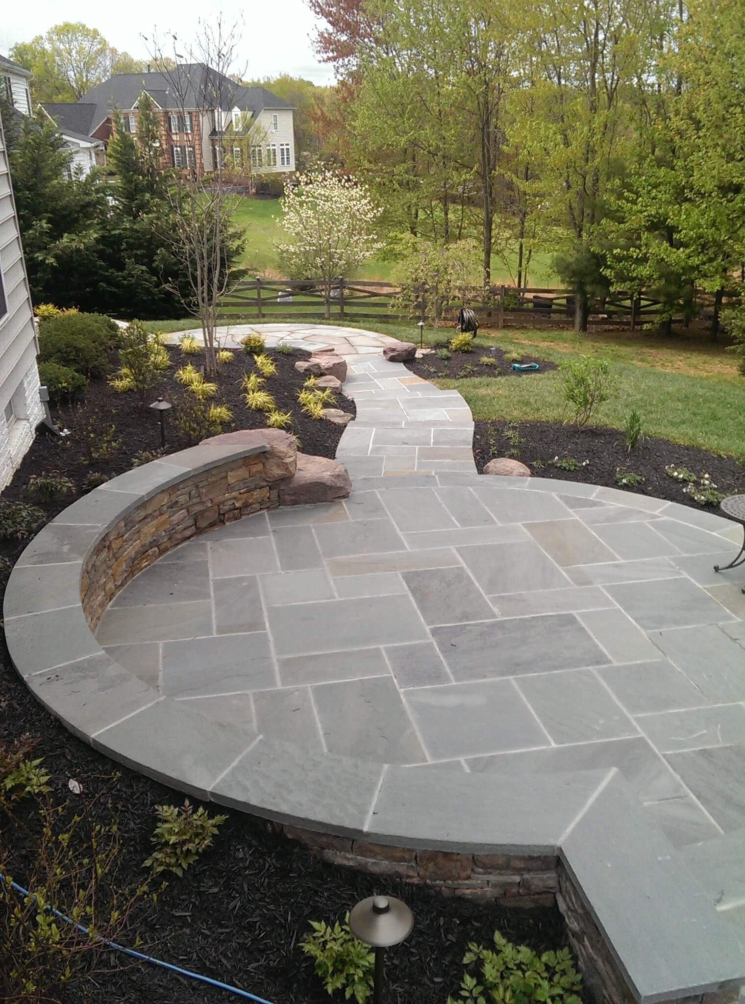 333 Circular Flagstone Patio with Flagstone Border and PA Beige Stone Sitting Wall with Flagstone Cap