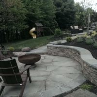 339 Stone Retaining Wall with Flagstone Cap Provides Patio with Extra Seating