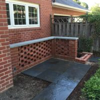 364 Pierced Brick Privacy Wall with Flagstone Cap