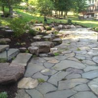 372 Informal Loosely-Laid Flagstone Patio with Boulders and Water Feature