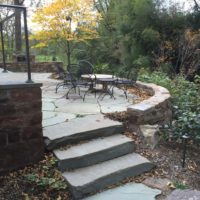 380 Informal Patio with Stone Retaining Wall and Stone Steppers to Flagstone Pathway