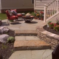 382 Flagstone Patio Off Deck with Boulders, Stone Retaining Wall and Stone Steppers