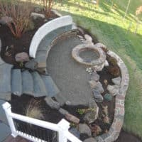 386 View from Deck of Stone Firepit and Custom Built-In Bench and Retaining Wall