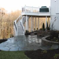 387 Lower Level Patio with Irregular Flagstone, Stone Retaining Wall and Water Feature