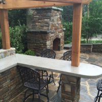 395 Outdoor Kitchen with Concrete Countertop and Cedar Pergola