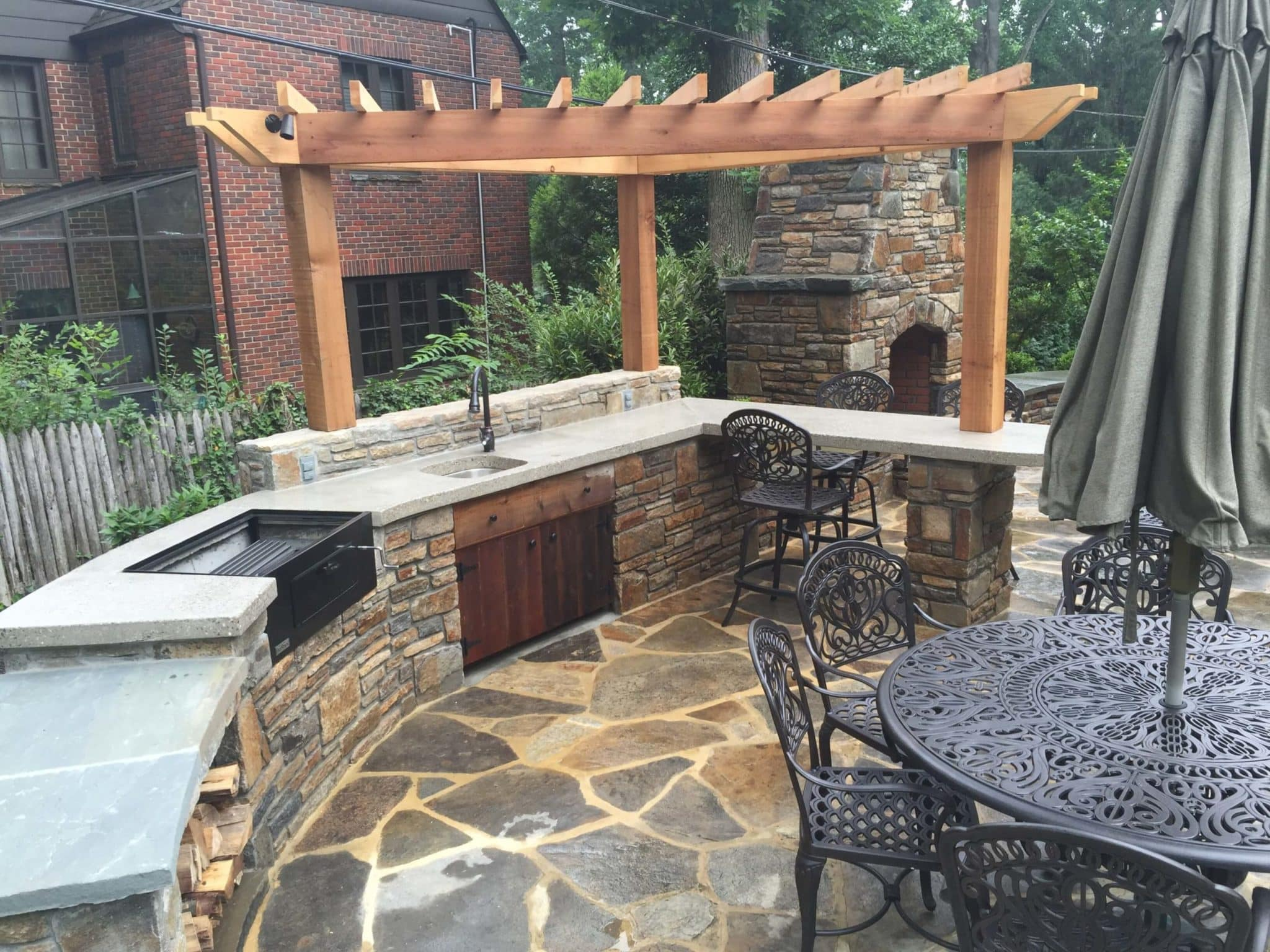 398 Outdoor Kitchen and Fireplace in Baltimore Wall Stone with Custom Cedar Pergola