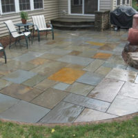4 Flagstone Patio with Wide Stone Landing and Double-Sided Stone Accent Wall