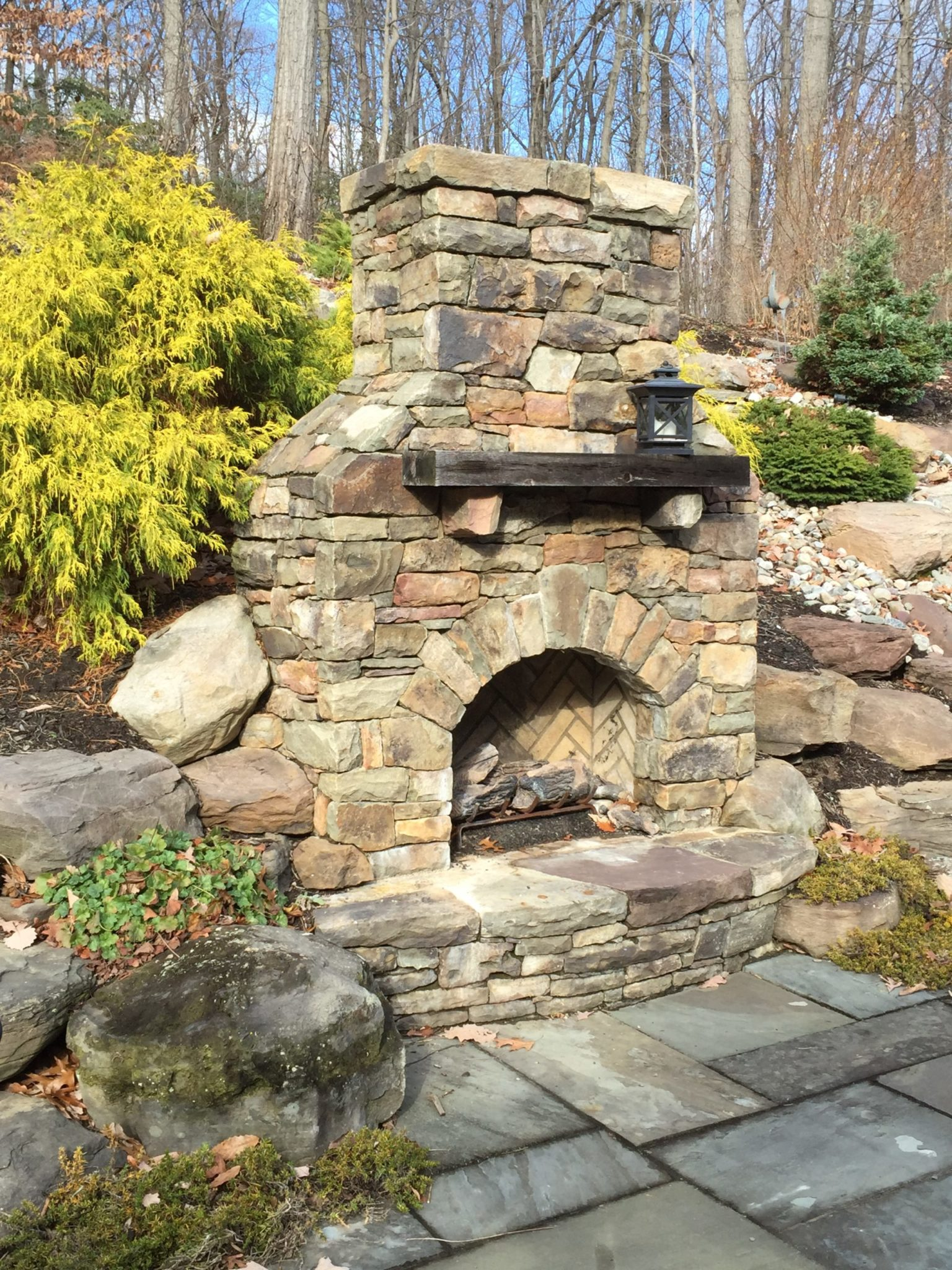 432 Stone Fireplace with Raised Stone Hearth Set Into Hillside
