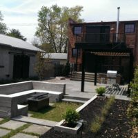 438 Urban Entertaining Space with Flagstone Patio, Custom Steel Pergola and Built-In Benches with Gas Fire Pit