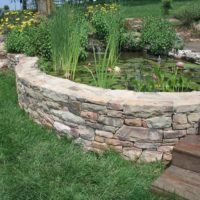 455 Curved Stone Sitting Wall and Water Feature