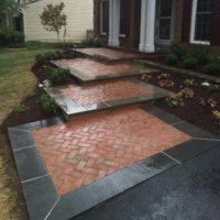 468 Front Brick Walkway Laid in Herringbone Pattern with Flagstone Border and Low Stone Garden Wall