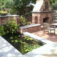 486 Brick and Flagstone Patios with Built-In Fish Pond, Brick Fireplace and Brick Walls with Flagstone Cap