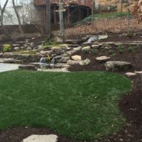 527 Hillside Landscape Features Boulders, Stone Walls and a Water Feature