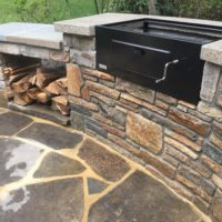 529 Built In Charcoal Barbecue with Baltimore Wall Stone and Concrete Countertop