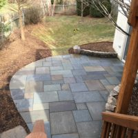 531 View from Deck of Lower-Level Flagstone Patio and Stone Garden Walls