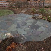 533 Informal Patio in Circular Shape with Irregular Flagstone and Flagstone Steppers