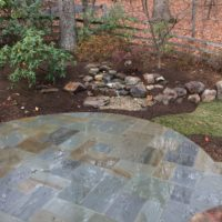 534 Flagstone Patio with Pondless Waterfall, Delaware Gravel and Boulders